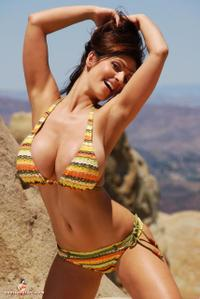 Denise Milani has 34DDD