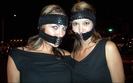 Sarah Larson and Amber Nichole photo wearing belts on their faces?