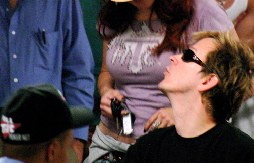 Phil Laak looking for kiss of good luck from Jen Tilly and her huge rack